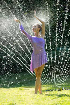 purples: Ballerina in water sprinkler
