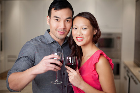 30 years old married couple: Couple toasting each other with wine