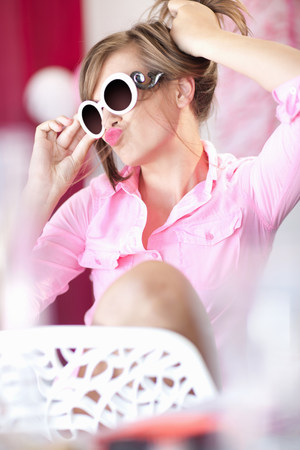 Teenage girl in sunglasses making face LANG_EVOIMAGES