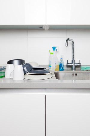 sinks: Washing up on kitchen sink LANG_EVOIMAGES