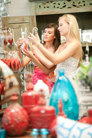 Woman shopping together in store LANG_EVOIMAGES