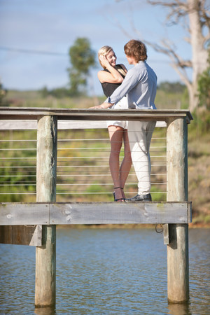 Couple smiling on wooden deck