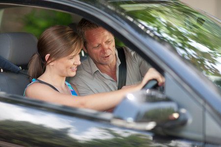 pa: Father teaching teenage daughter driving