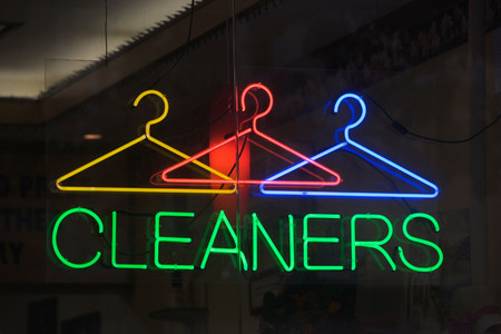 coathangers: Neon sign reading cleaners in window