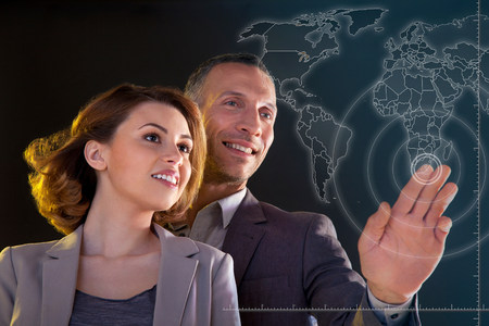 new age: Businesspeople touching world map