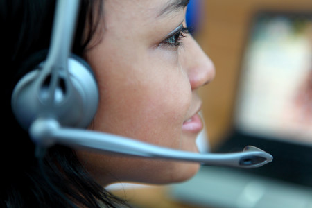 Close up of businesswoman in headset LANG_EVOIMAGES