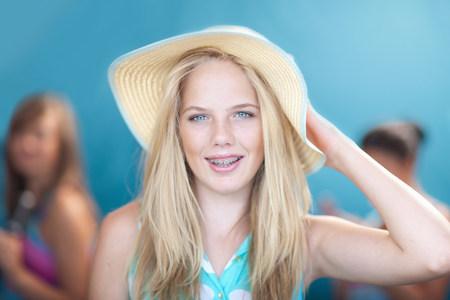 tweens: Teenage girl wearing floppy hat LANG_EVOIMAGES