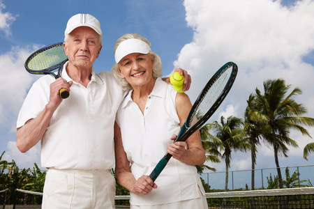 70s tennis: Senior couple ready for tennis