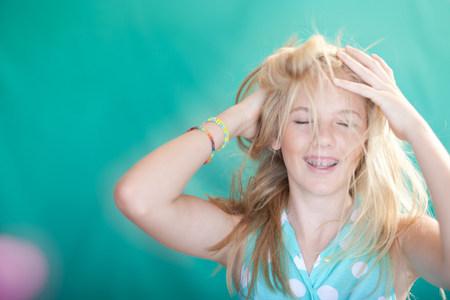 Teenage girl tossing her hair