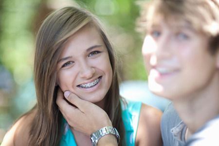 teenaged boy: Teenage girl smiling with boyfriend