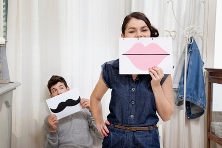 silliness: Couple holding lips and moustache