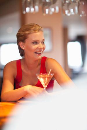 Woman having drink at bar LANG_EVOIMAGES