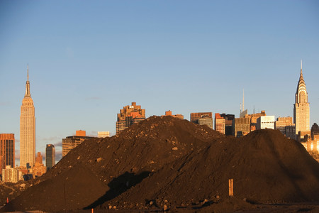 Pile of soil in front of Manhattan skyline,New York City LANG_EVOIMAGES