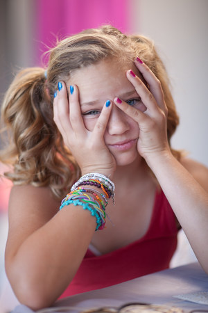 fedup: Frustrated girl with head in hands