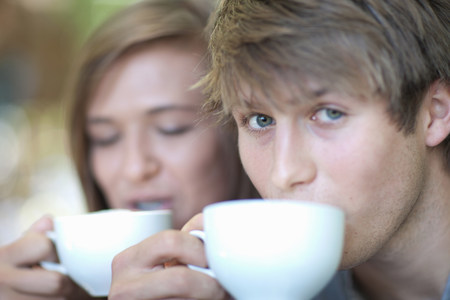 Couple drinking coffee together outdoors