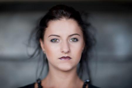 Teenage girl wearing dark makeup