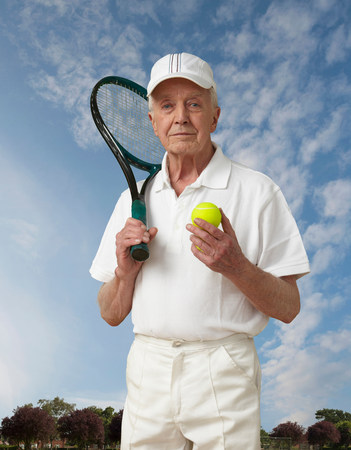 70s tennis: Portrait of a senior man with tennis gear