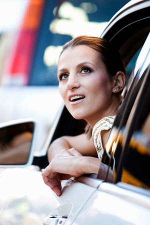 astonish: Woman looking out car window