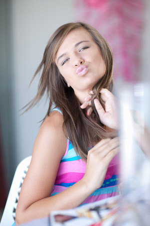 puckered: Teenage girl making kissy face