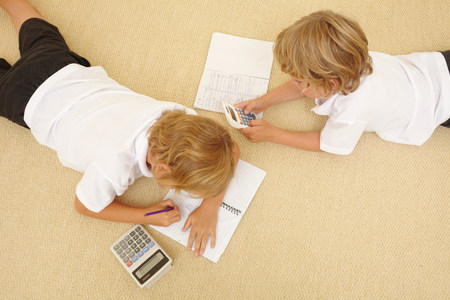 top 7: Two schoolboys doing homework
