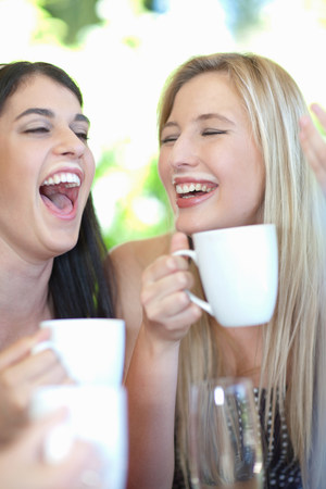 lit image: Women laughing and drinking coffee