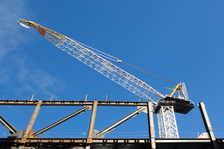 housebuilding: Low angle view of crane at construction site LANG_EVOIMAGES