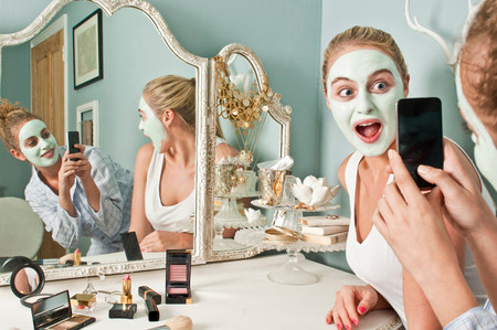 narcissist: Woman wearing face mask being photographed by friend