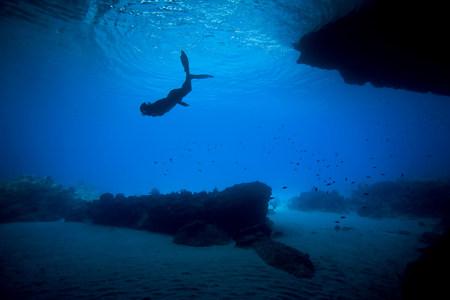 dive trip: Woman snorkeling in tropical water