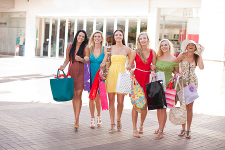 Women carrying shopping bags outdoors