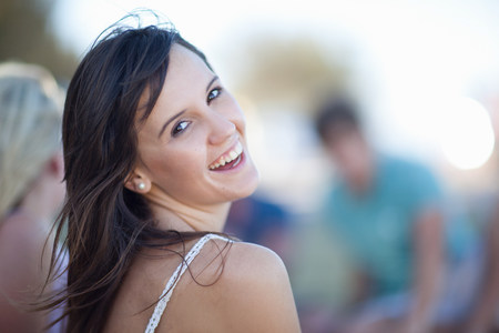 Woman laughing outdoors LANG_EVOIMAGES