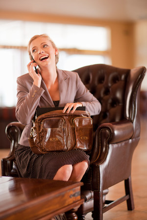 only 1 woman: Businesswoman on cell phone in lobby