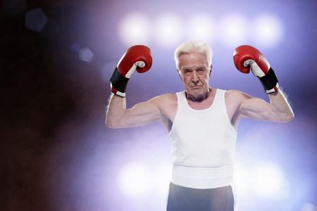 enraged: Senior male boxer,looking tough
