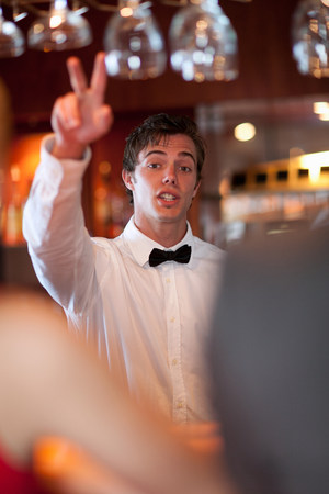 19 year old boy: Waiter offering more drinks at bar