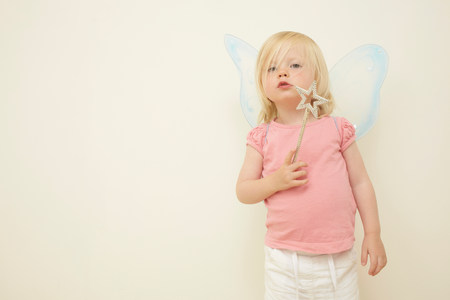 Toddler wearing wings,holding wand