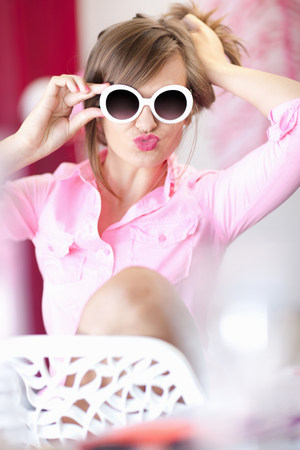 puckered lips: Teenage girl in sunglasses making face LANG_EVOIMAGES