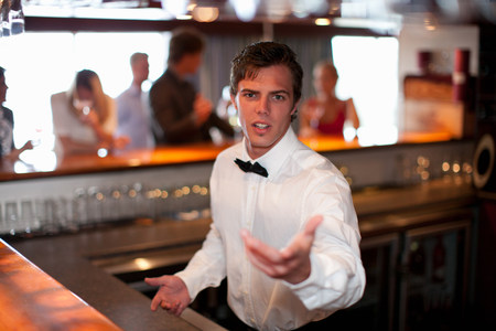 19 year old boy: Waiter taking order at restaurant bar