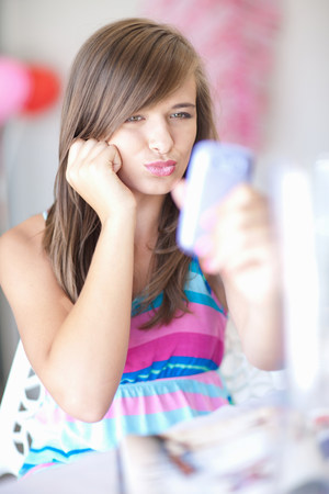 check out: Teenage girl taking picture of herself LANG_EVOIMAGES