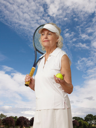 70s tennis: Portrait of a senior woman with tennis gear