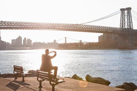 negative area: Man taking pictures of urban bridge