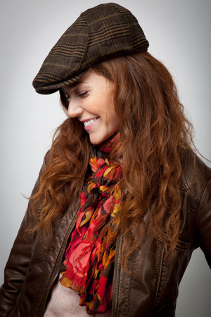 berets: Smiling woman wearing hat and jacket