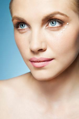 ponderous: Woman with eye cream around eye