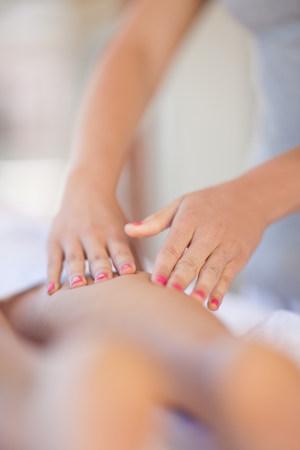 lies down: Woman having leg massage