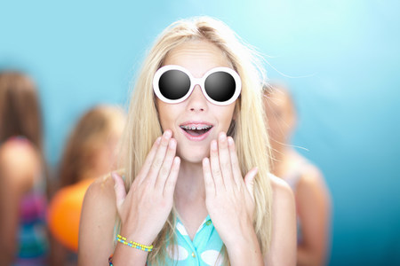 gasping: Teenage girl in sunglasses gasping