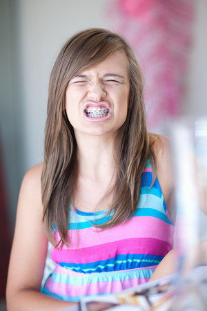 Teenage girl showing her braces LANG_EVOIMAGES