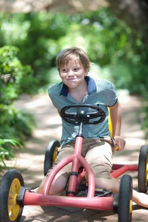 transportation: Boy riding go-kart on path LANG_EVOIMAGES