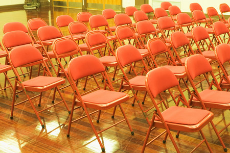 Empty chairs in auditorium LANG_EVOIMAGES
