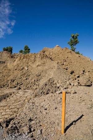 Surveyors marker in construction site LANG_EVOIMAGES