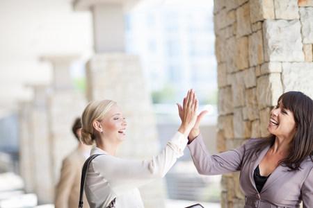 negative area: Businesswomen high giving in walkway