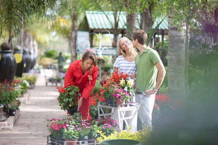 Friends shopping for plants in nursery LANG_EVOIMAGES