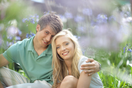 19 year old boy: Smiling couple sitting in tall plants